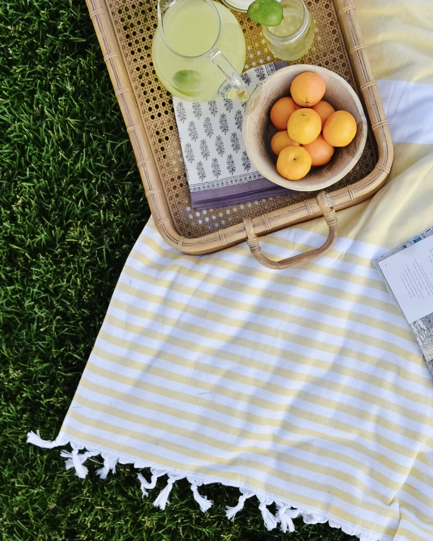 Yellow towel with rattan tray